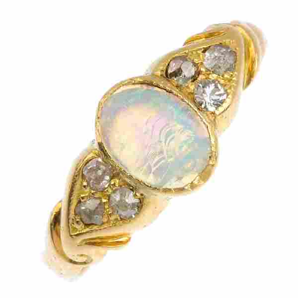 An opal and diamond dress ring. The oval opal cabochon,