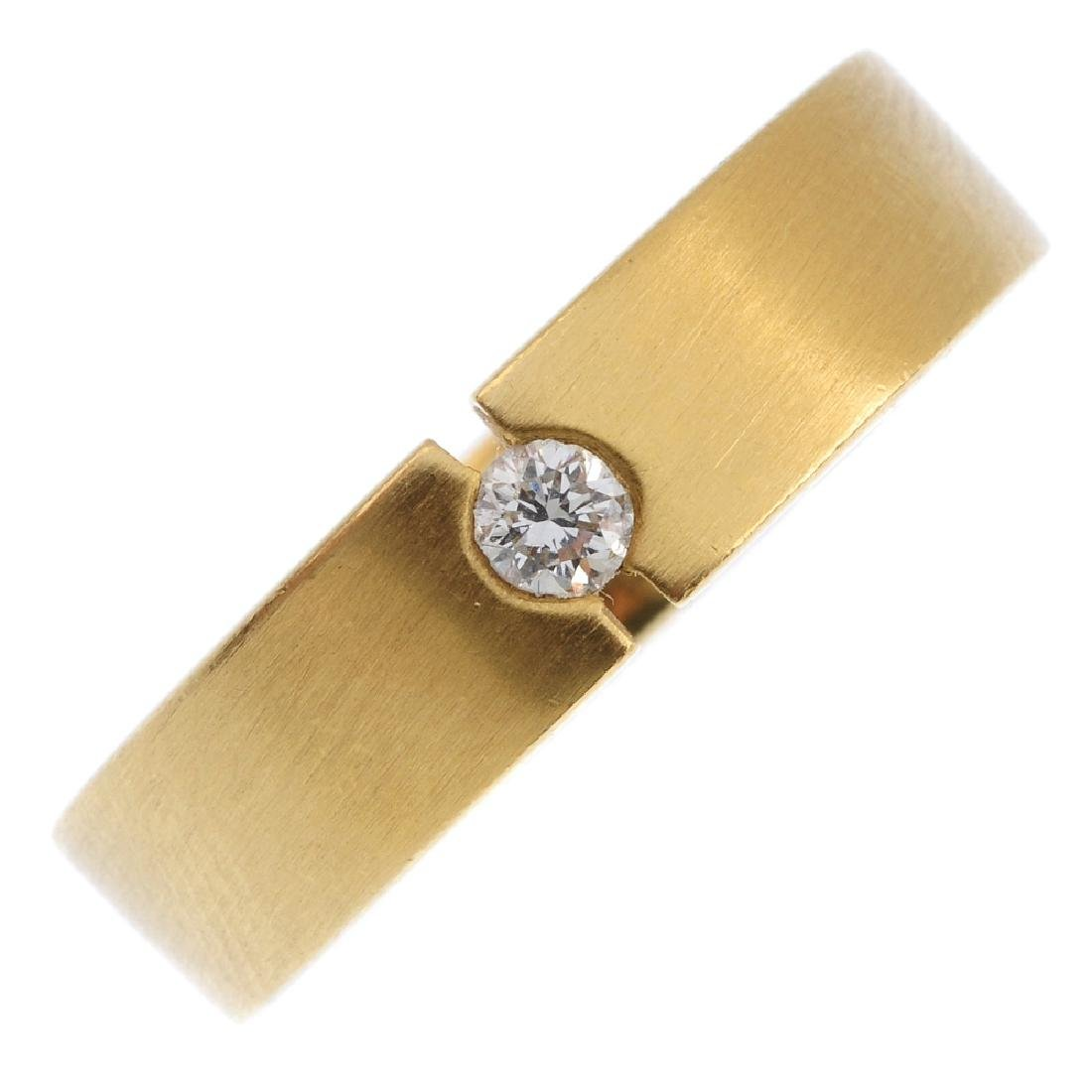 An 18ct gold diamond band ring. The brilliant-cut