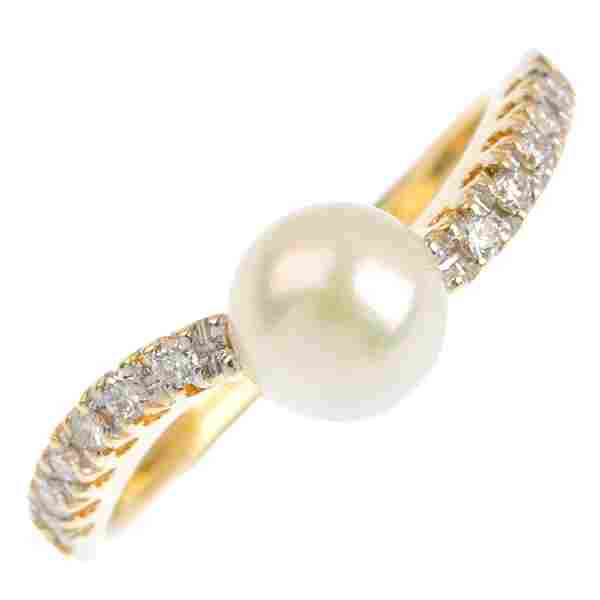 An 18ct gold cultured pearl and diamond ring. The