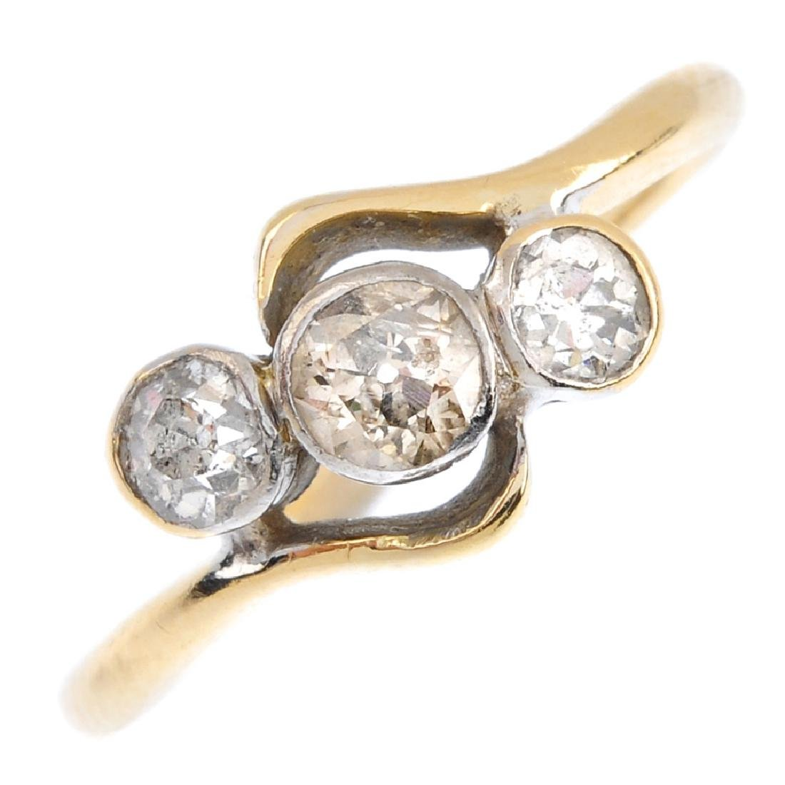 A diamond three-stone ring. The graduated old-cut