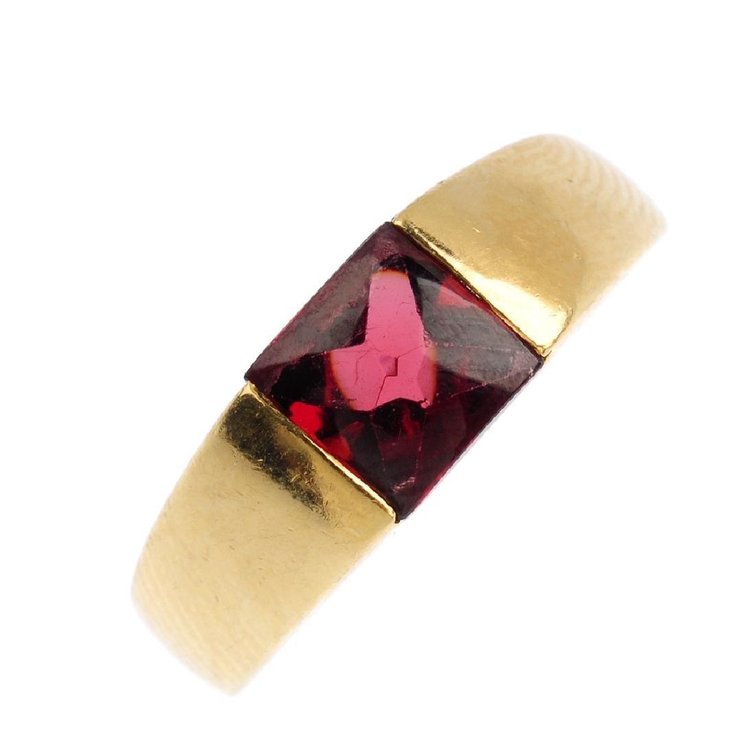 An 18ct gold garnet ring. The square-shape garnet