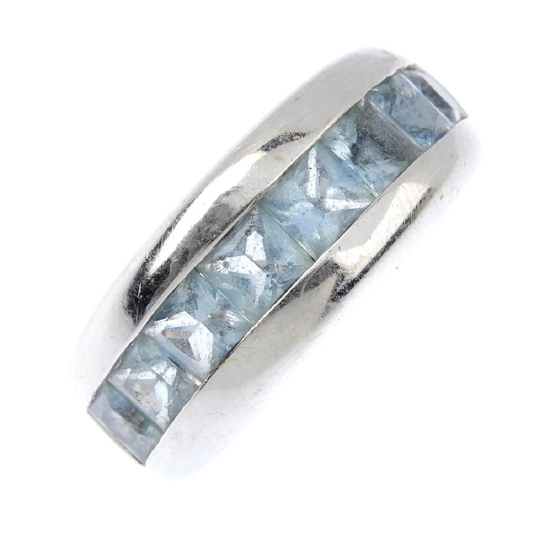 An aquamarine band ring. The slightly graduated