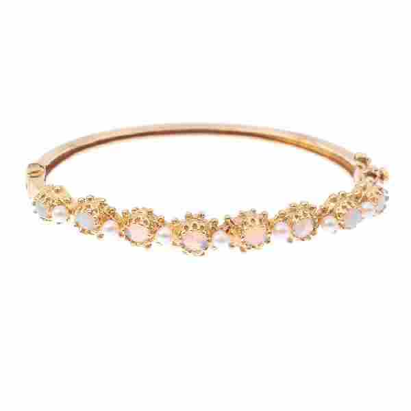 An opal and seed pearl hinged bangle. Designed as an