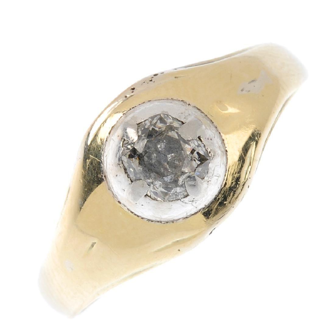 A diamond single-stone ring. The old-cut diamond