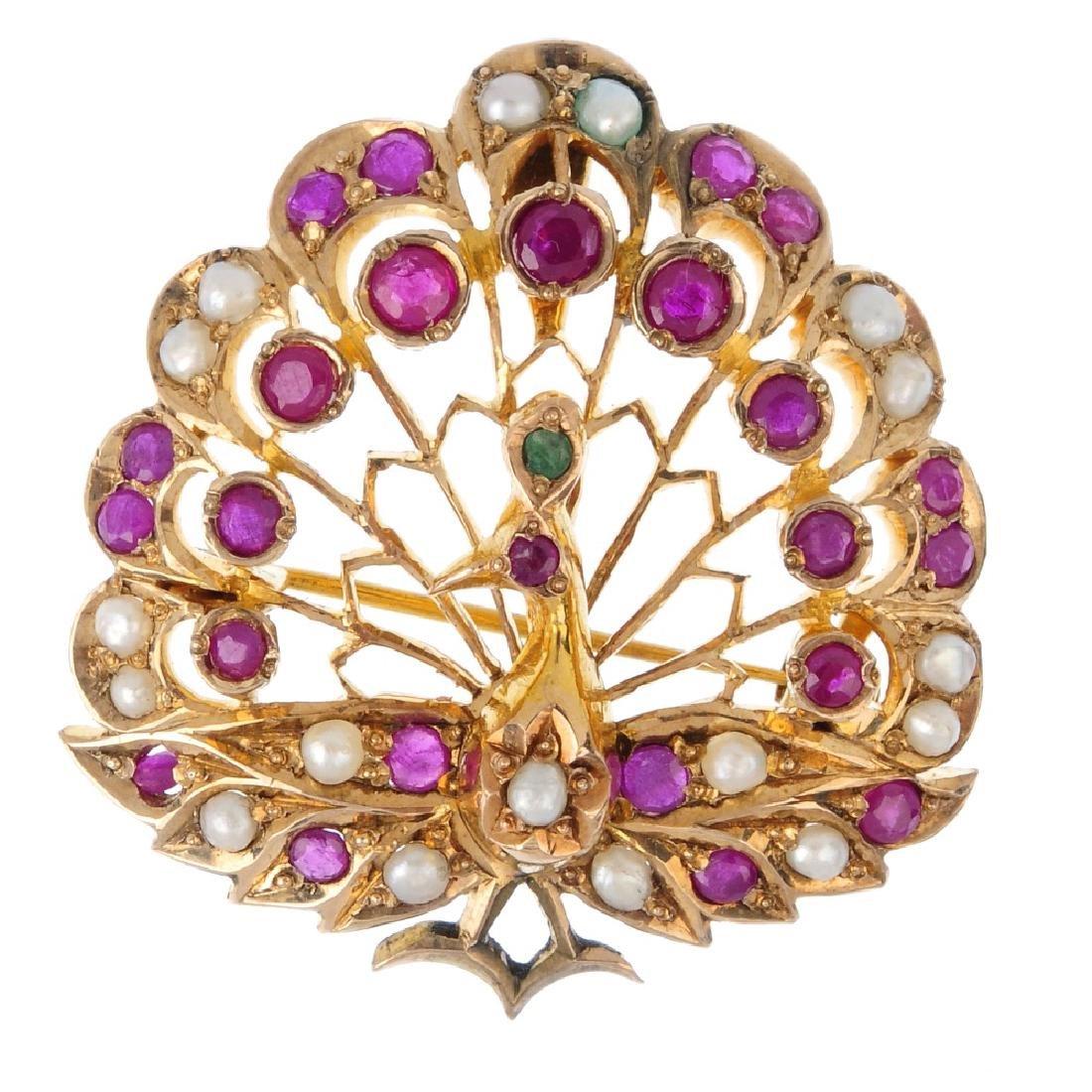 A gem-set peacock brooch. Of openwork design, the split