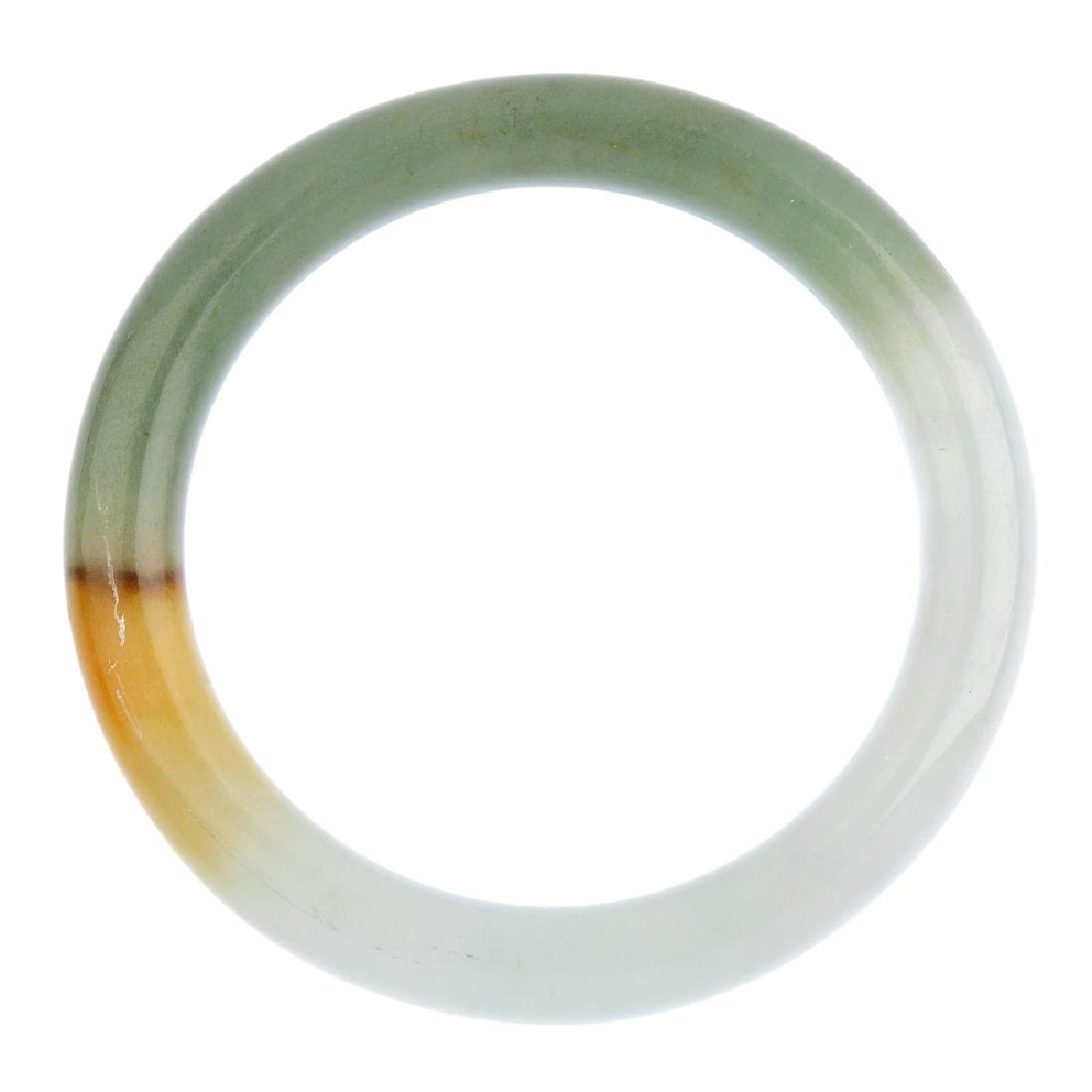 A jade bangle. Designed as a plain bangle, measuring
