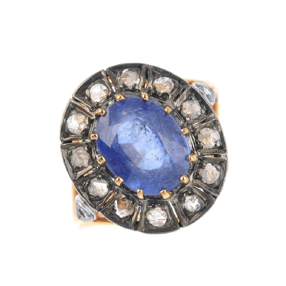A diamond and glass-filled blue-gem cluster ring. The