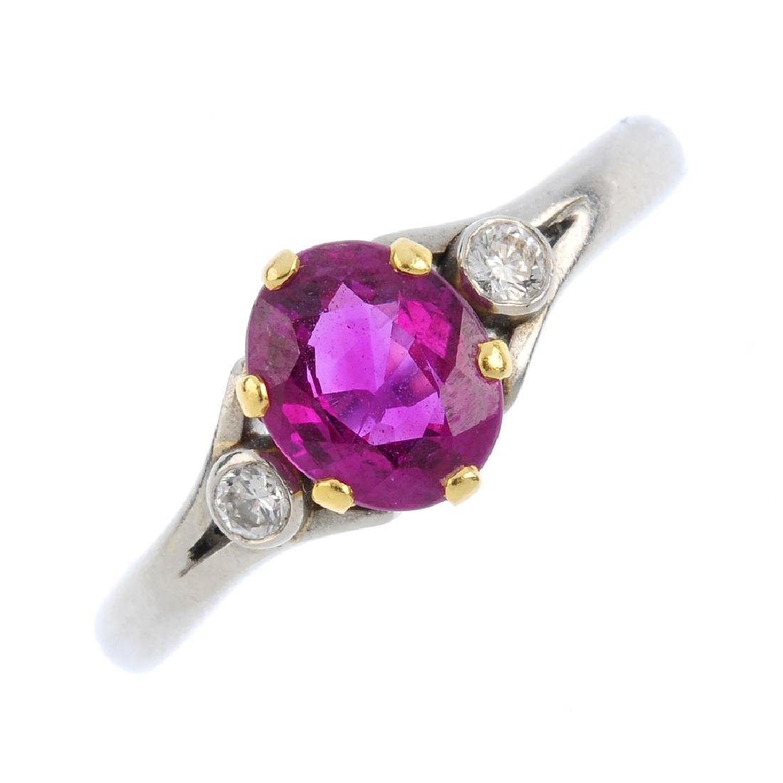 A platinum ruby and diamond ring. The oval-shape ruby,