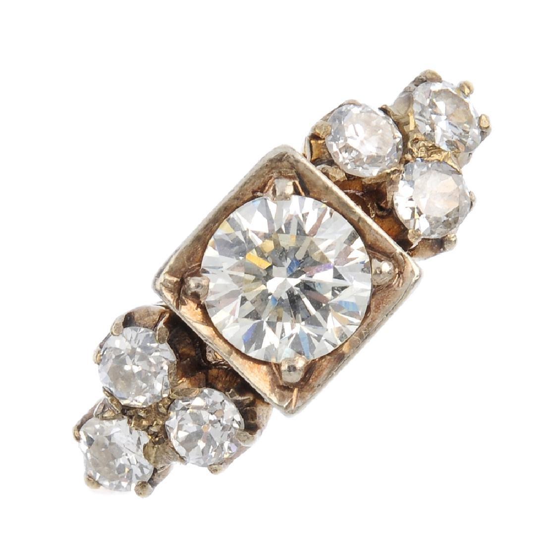 A diamond dress ring. The brilliant-cut diamond, with