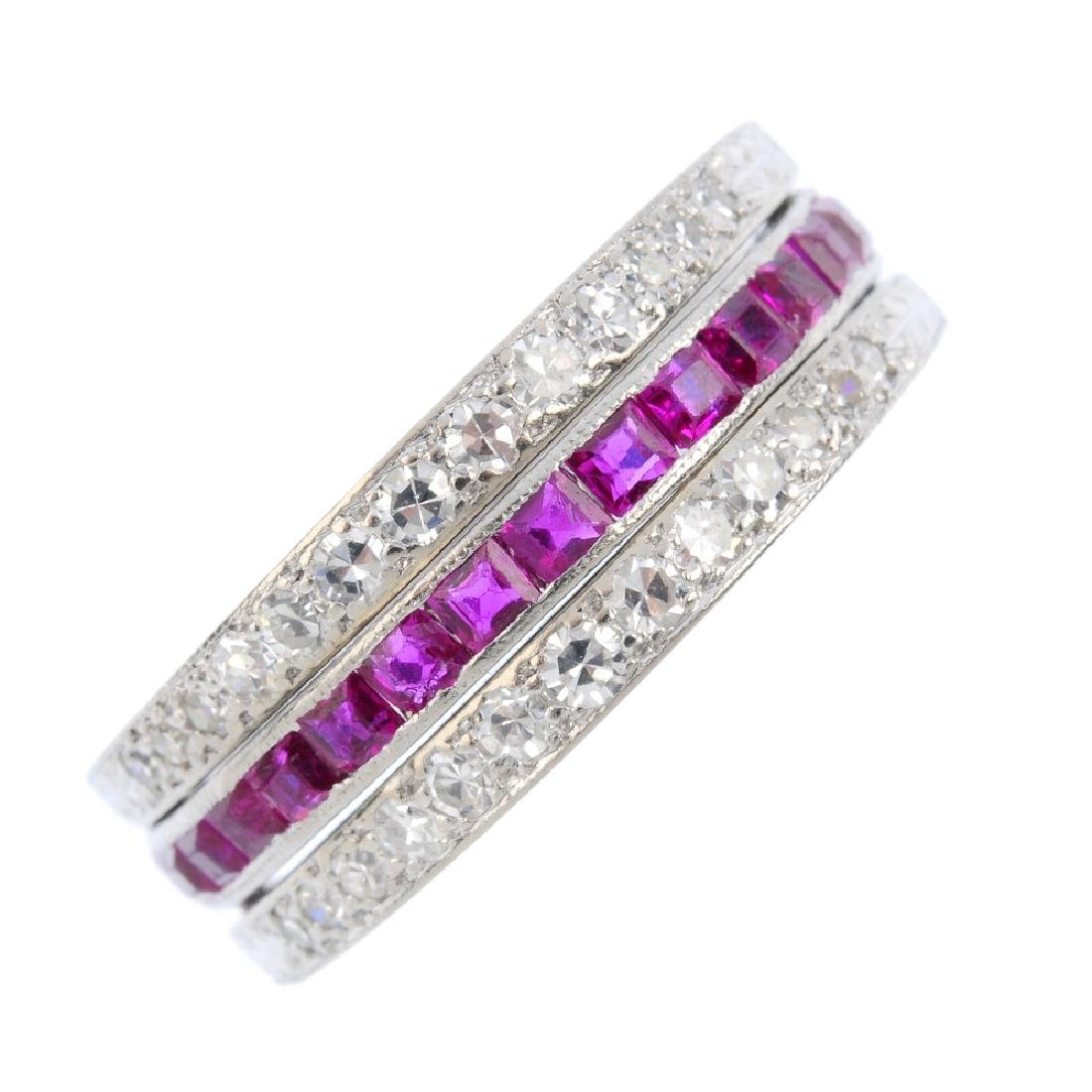 A ruby, sapphire and diamond eternity flip ring. The