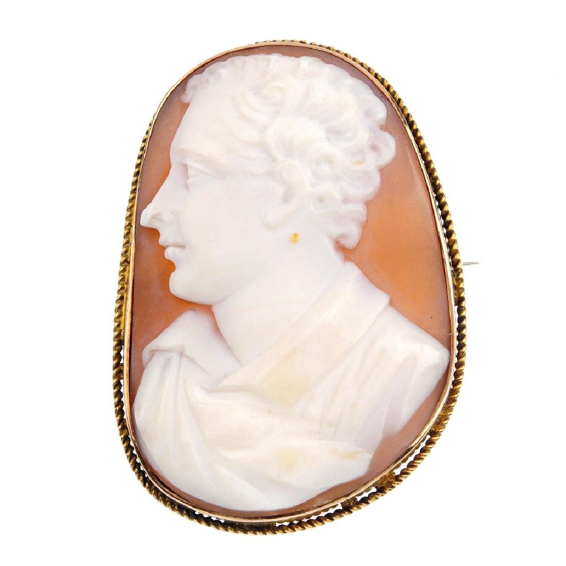 A late Victorian gold shell cameo brooch. Of irregular
