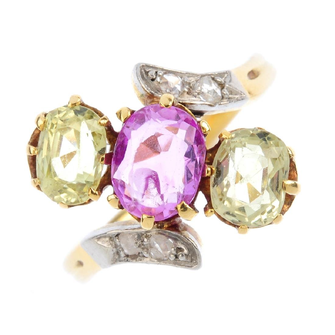 A sapphire and chrysoberyl three-stone ring. The