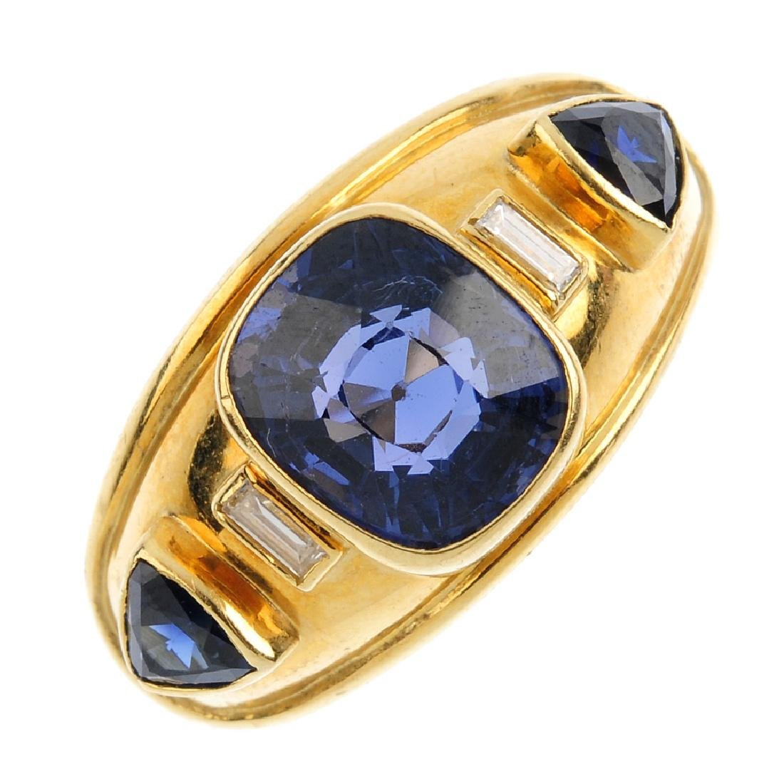 An 18ct gold spinel, sapphire and diamond ring. The