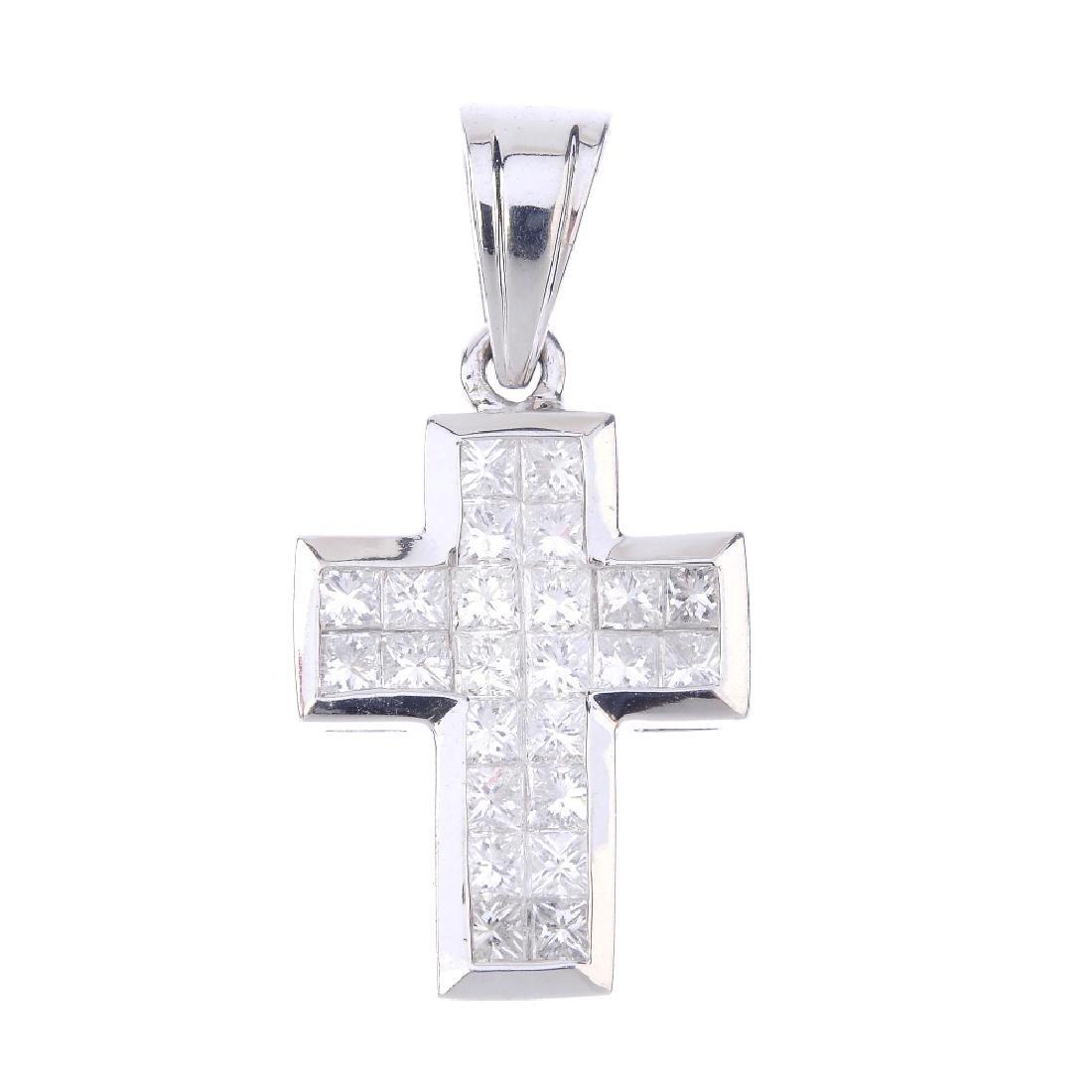 An 18ct gold diamond cross pendant. Designed as a