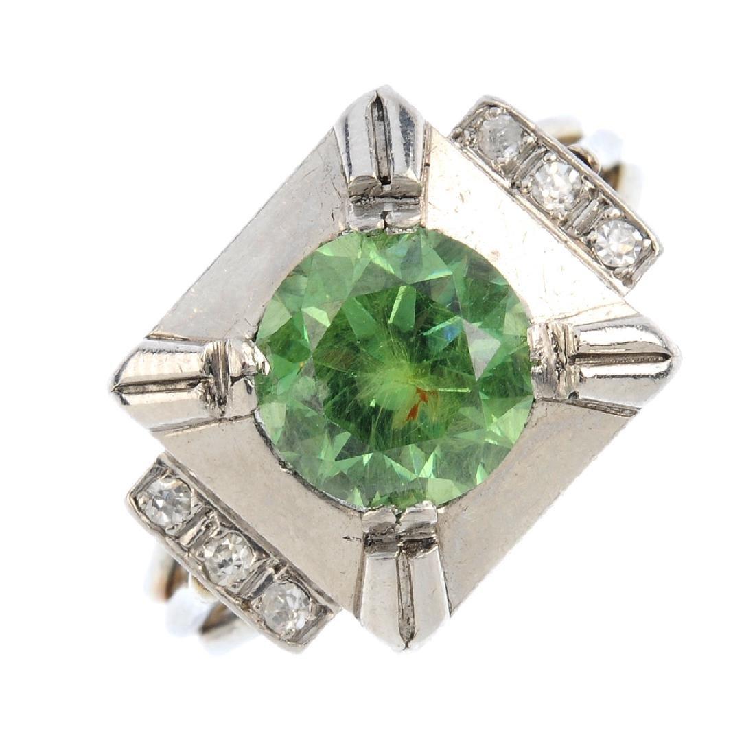 A demantoid garnet and diamond dress ring. The