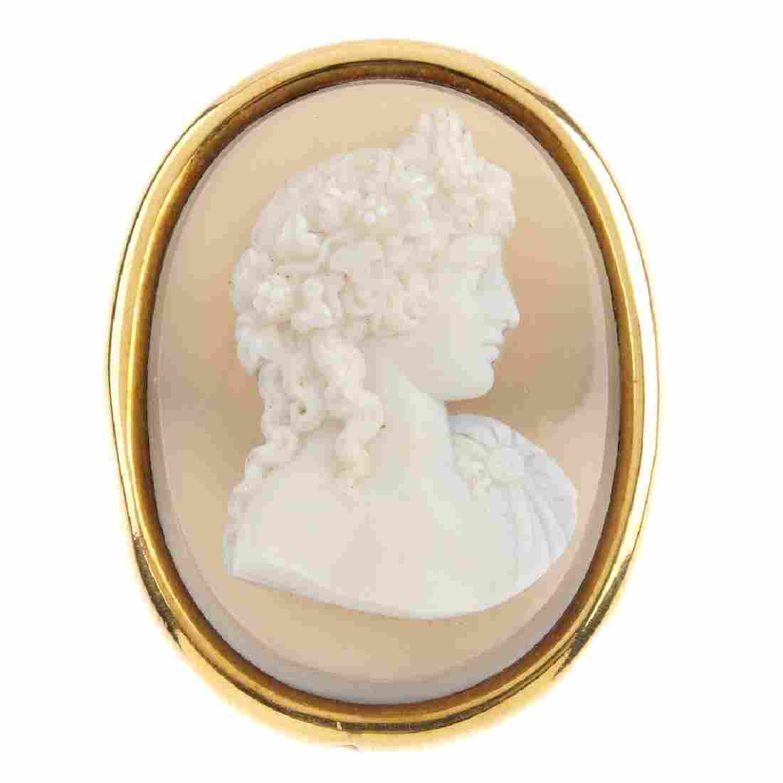 A late Victorian gold cameo brooch. The oval hardstone,