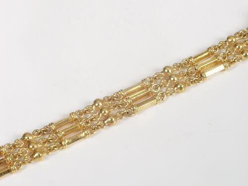 1005: 18ct gold three row fancy bar/chain lin