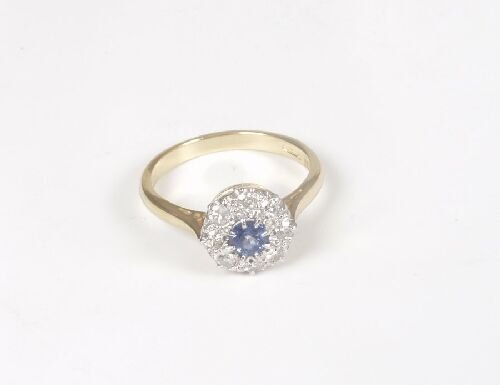 1006: 18ct gold circular sapphire and diamond