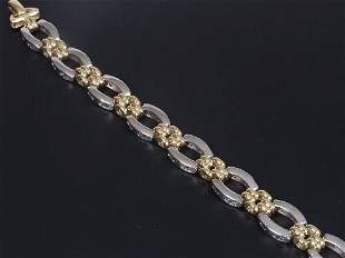 18ct bi-colour gold bracelet of oval wh