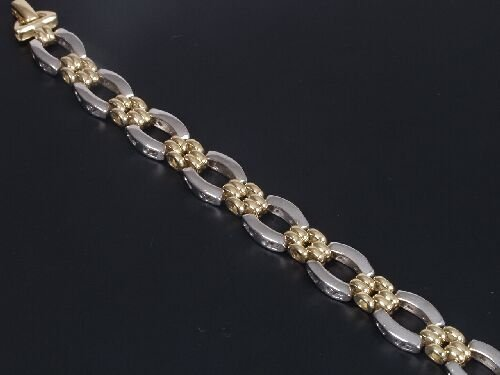 1021: 18ct bi-colour gold bracelet of oval wh