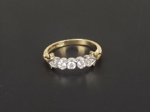 1023: 18ct gold five stone diamond half hoop