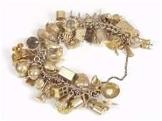 1659B: 9ct gold curb link charm bracelet wit