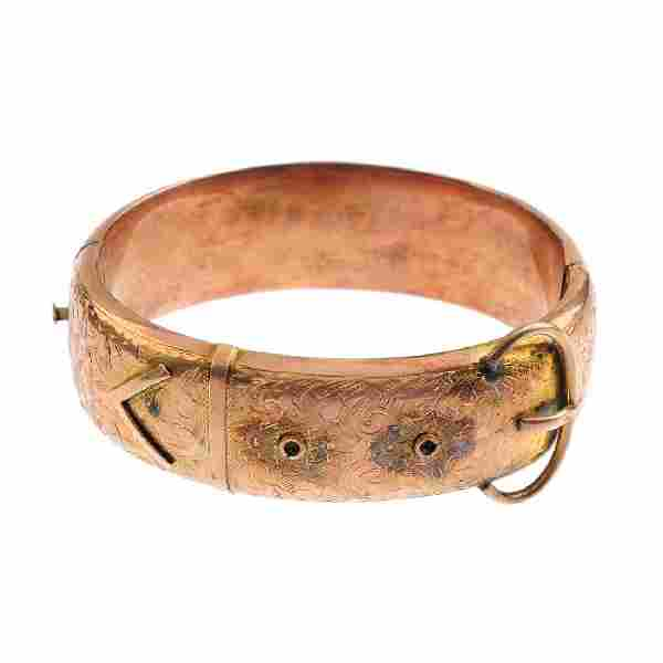 An early 20th century 9ct gold hinged bangle. Designed