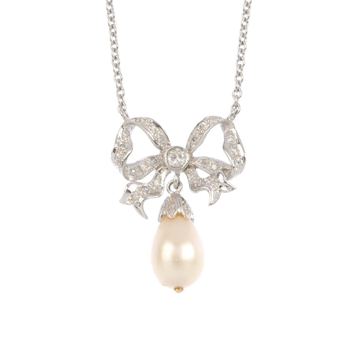 A natural pearl and diamond pendant. The natural