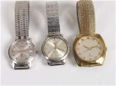 2065: LONGINES - three gentleman's watches, c