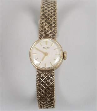 LONGINES - a lady's 1960's 9ct gold bra