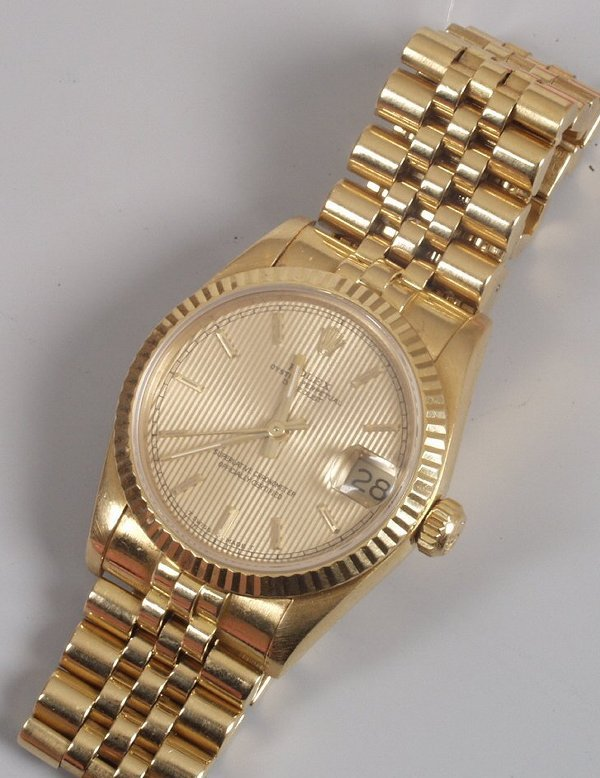 2136: ROLEX - a 1980's midsize 18ct yellow go