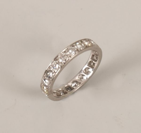 3:  A diamond full eternity ring set with twenty one ro