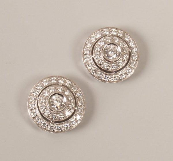 5: Pair of 18ct white gold diamond set three tier stud