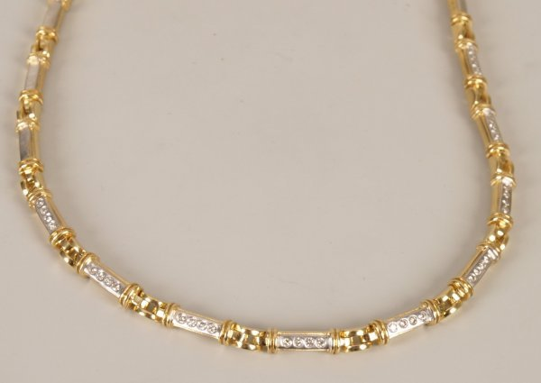 11: 18ct bi-colour diamond necklet with nine central pa