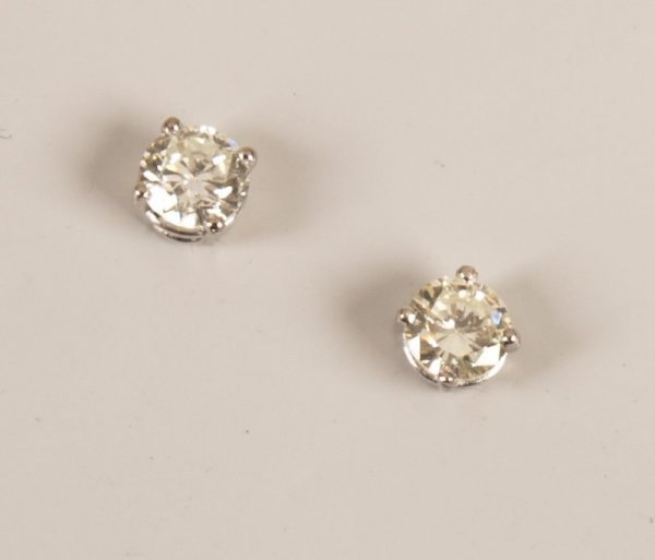 12:  Pair of 18ct white gold single stone diamond stud