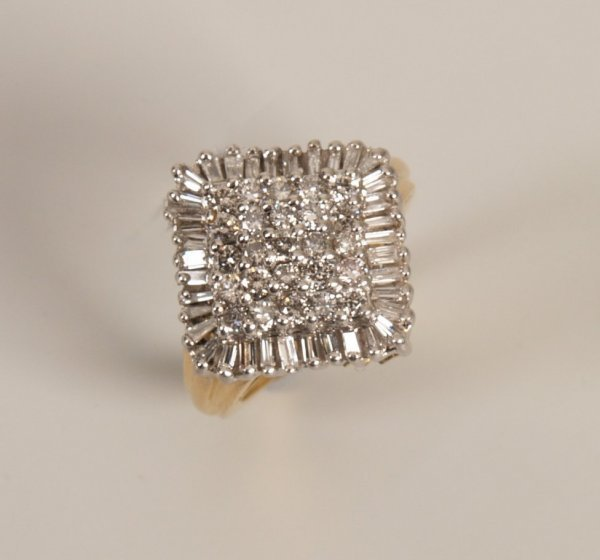15: 18k gold diamond cluster ring in a square design wi