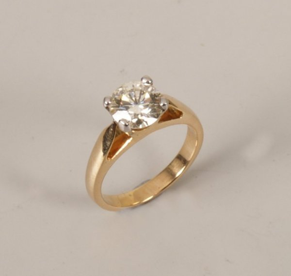 17: 18k gold single stone diamond ring set a round bril