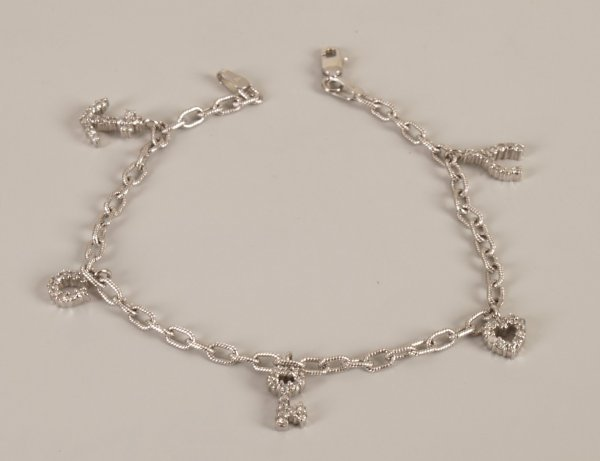 22: 14k white gold diamond charm bracelet in a belcher