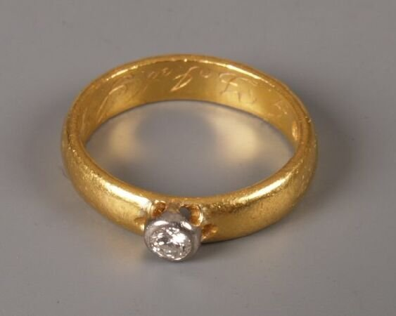 2: Victorian high carat gold band ring with a collet se