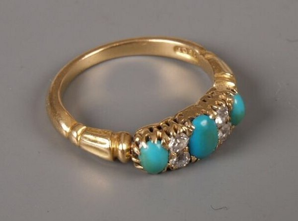 6: 18ct gold half hoop ring set with three oval turquoi