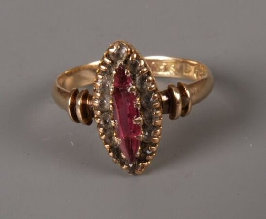 7: Victorian 9ct gold ruby and white paste marquise clu