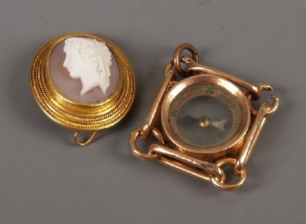 10: Rose gold compass pendant and a shell cameo brooch