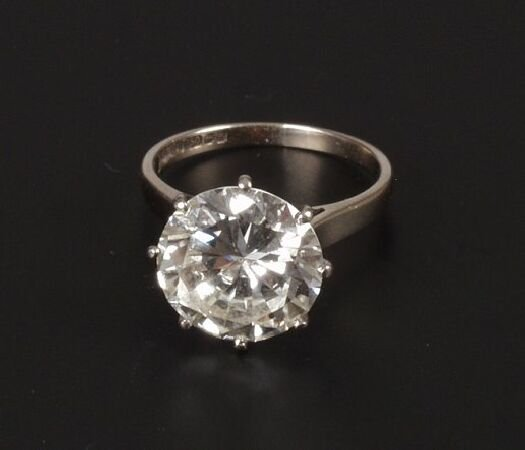 19: A round full cut brilliant diamond of 4.90 cts in 1