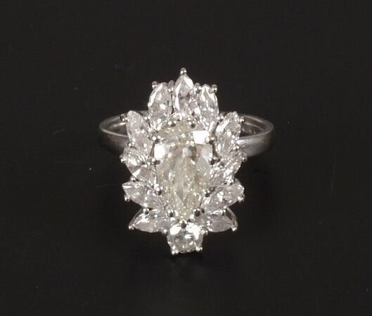 22: An all diamond cluster ring with a pear shaped cent