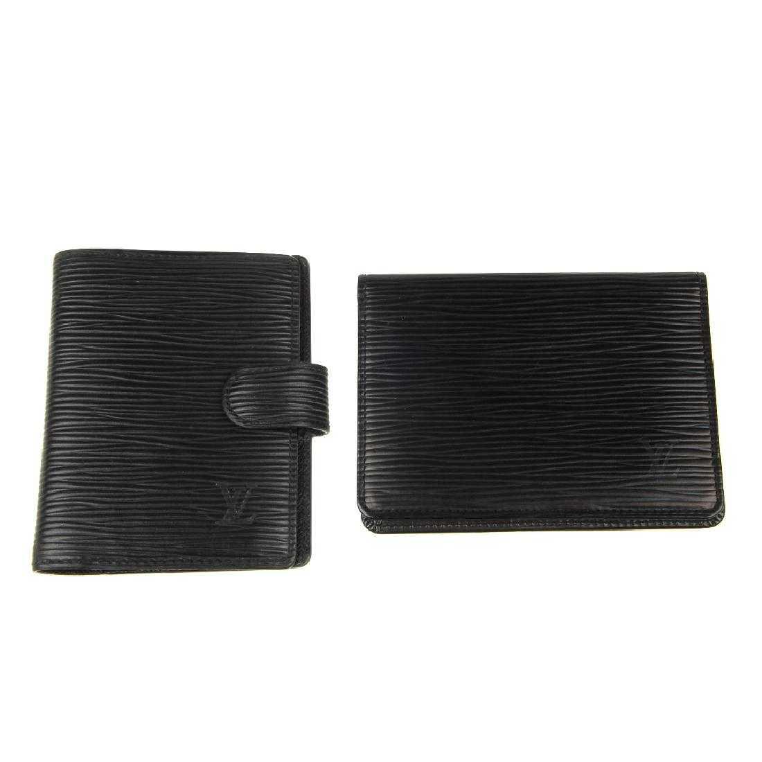 c1baa2180f2c LOUIS VUITTON - two black Epi leather wallets. To