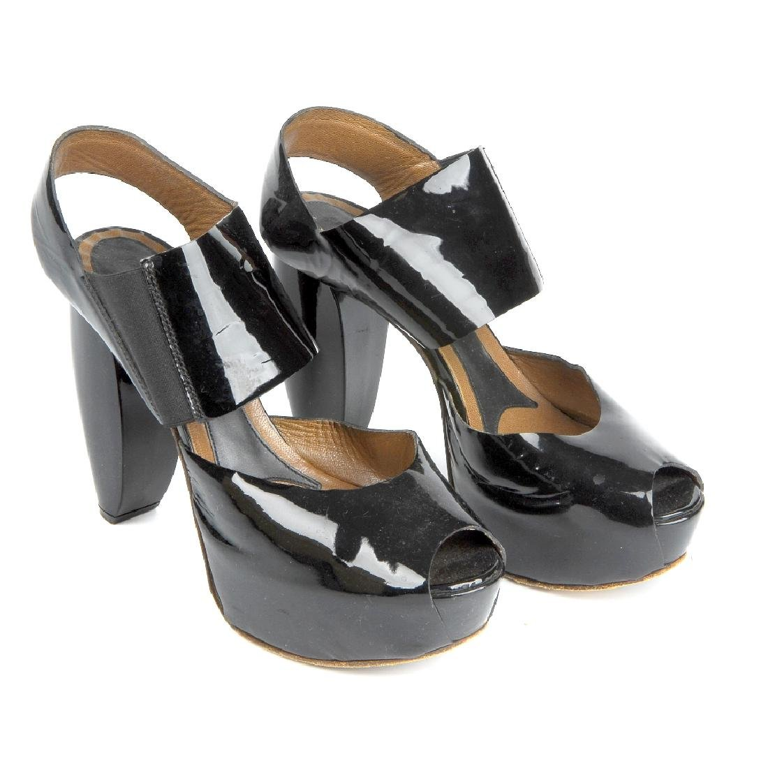 MARNI - a pair of platform sandals. Crafted from black