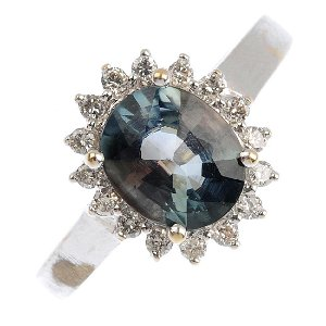 An andalusite and diamond cluster ring. The oval-shape