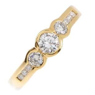 A diamond dress ring Comprising three graduated