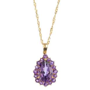 A 9ct gold amethyst cluster pendant The pearshape