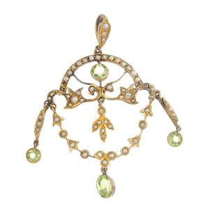 An Edwardian 9ct gold peridot and seed pearl pendant